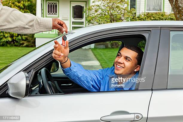 young man borrowing friend's car - borrowing stock pictures, royalty-free photos & images