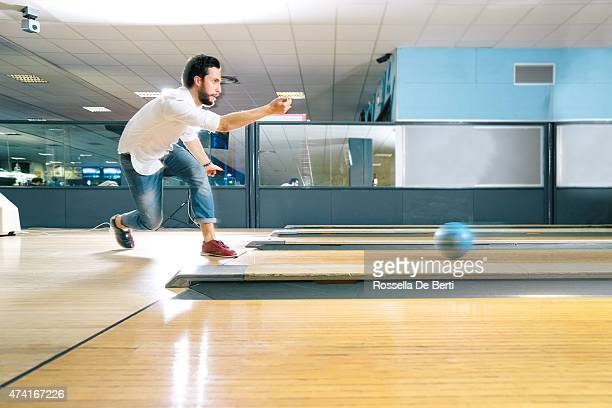 young man bowling - bowling stock pictures, royalty-free photos & images
