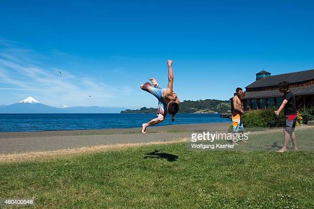 Young man break dancing on the lake promenade in Frutillar a small town on Lake Llanquihue in the Lake District near Puerto Montt Chile with Osorno...