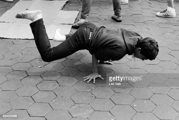 A young man breakdances in Washington Square Park New York New York early 1980s