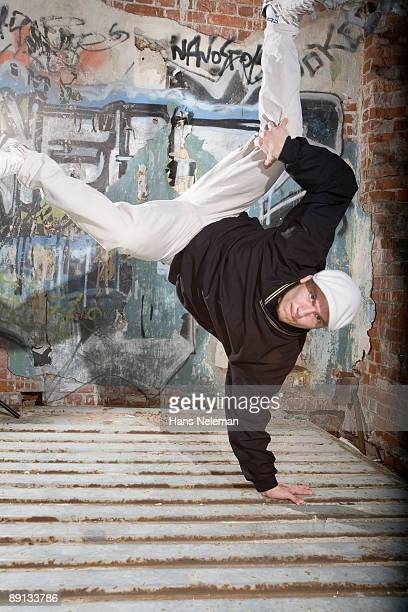 Young man breakdancing in a street, Moscow, Russia