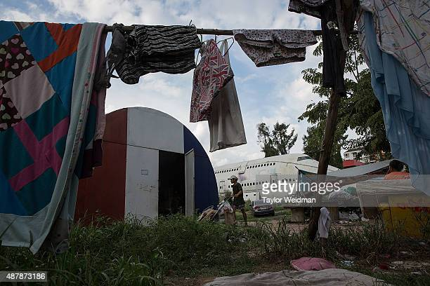 A young man brings goods into his home in a disused airplane on September 12 2015 in Bangkok Thailand 3 impoverished Thai families have begun living...