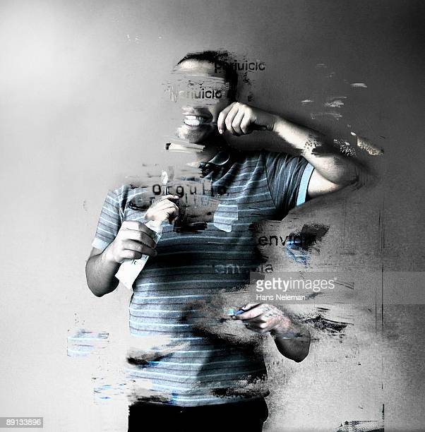 Young man brushing his teeth and erasing himself
