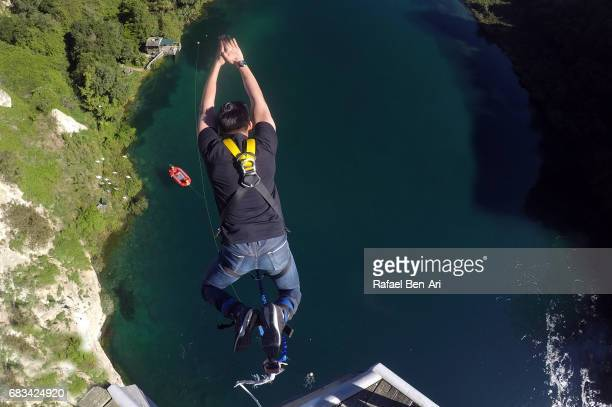 Young man bungy jump in Tapou New Zealand