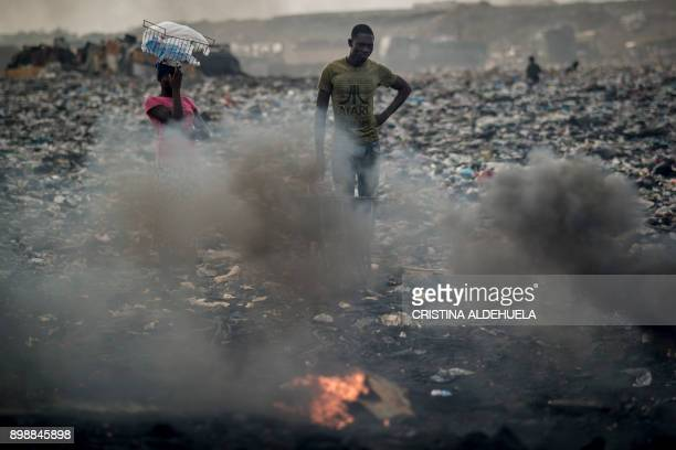 A young man burns electronic waste at Agbogbloshie dumpsite in Accra on November 29 2017 The dumpsite is located in Agbogbloshie slum a former...