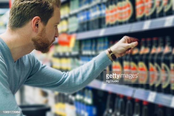 Young man buying beer