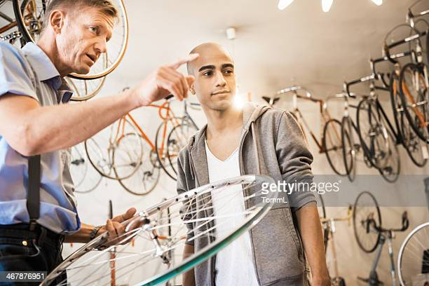 Young Man Buying Bicycle