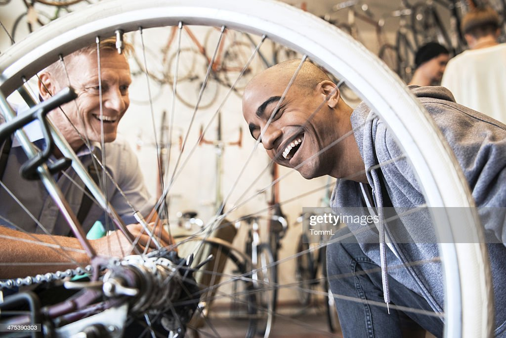 Young Man Buying Bicycle : Stock Photo