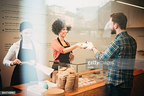 Young man buying   food  snack bar