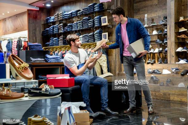 young man buying new shoes - men fashion stock photos and pictures