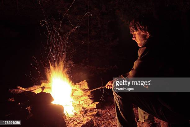 Young Man by the Campfire