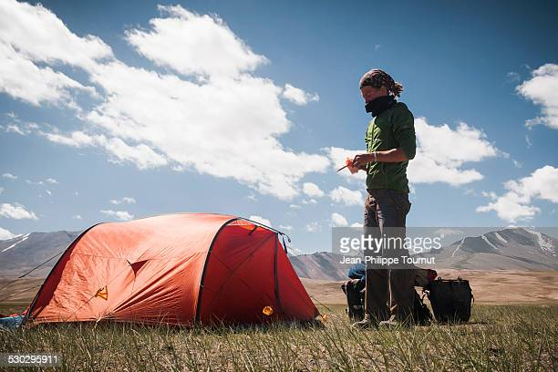 Young man camping in the Pamirs of Tajikistan