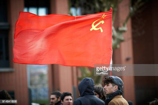A young man carries a red flag during the demostration More than 1000 students highschool students teachers demonstrated against the Vidal's law...