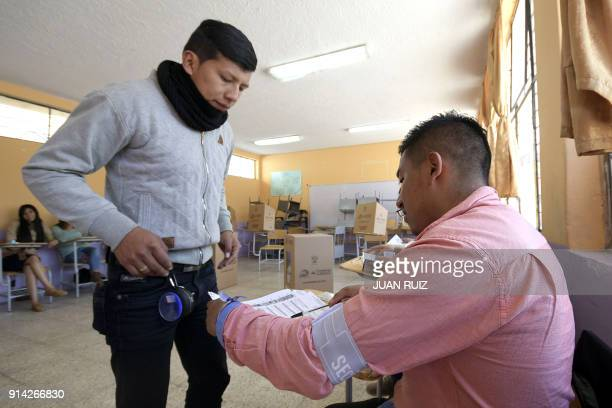 A young man casts his vote at a polling station in the Quito neighborhood of Zambiza during a referendum called by President Lenin Moreno on February...