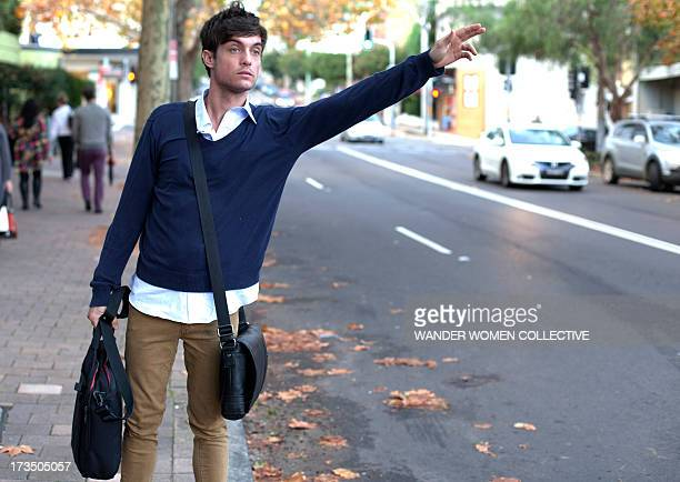 Young Man catching cab from work in Sydney