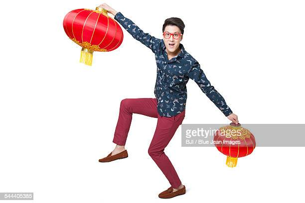 Young man celebrating Chinese new year with Chinese lanterns