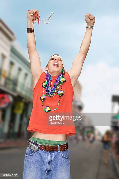 young man celebrating mardi gras - mardi gras beads stock photos and pictures