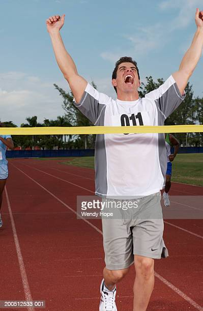 Young man cheering as wins race