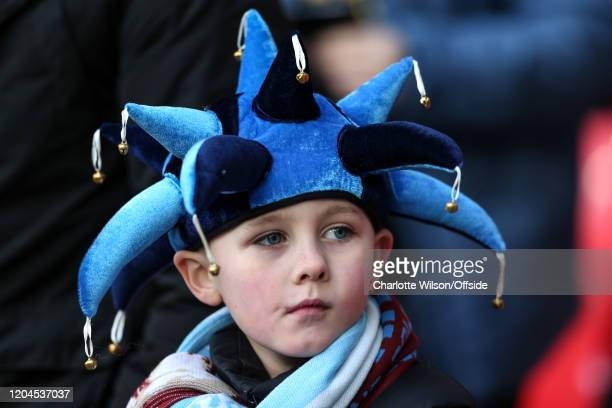 A young Man City fan in a blue jester hat during the Carabao Cup Final between Aston Villa and Manchester City at Wembley Stadium on March 1 2020 in...