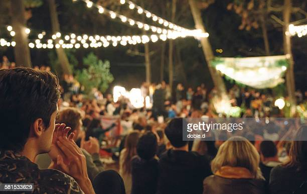 young man clapping in night music festival - outdoor party stock pictures, royalty-free photos & images