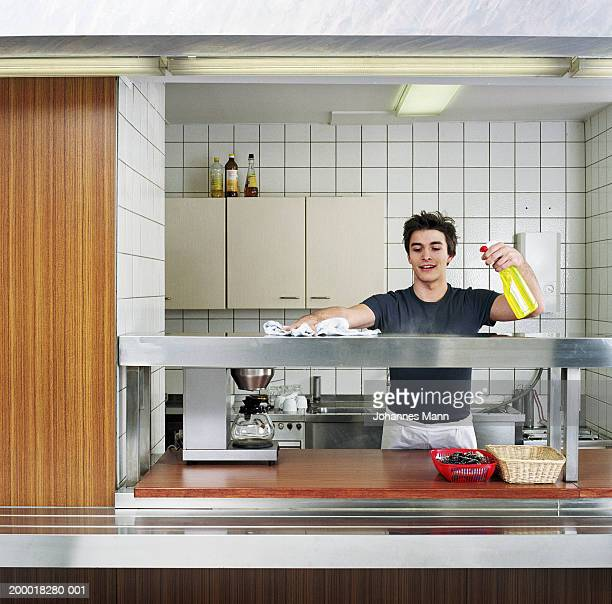 young man cleaning canteen kitchen - part time job stock pictures, royalty-free photos & images