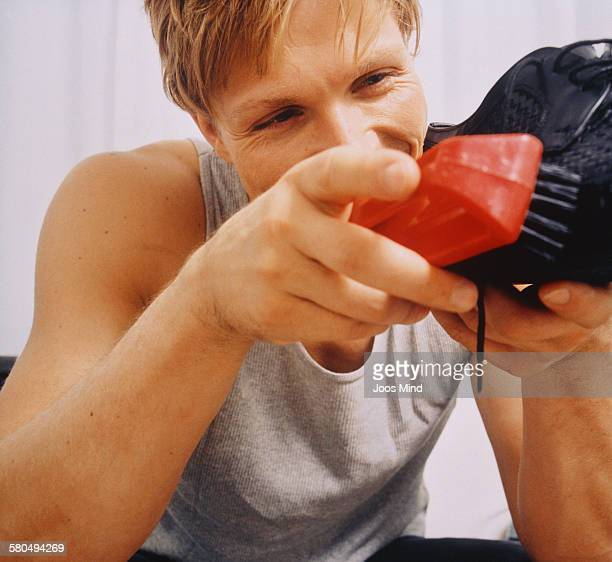 Young Man Cleaning Shoe