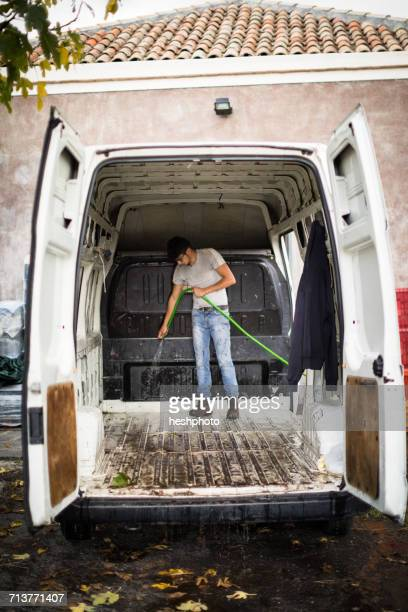 young man cleaning vineyard van - heshphoto photos et images de collection
