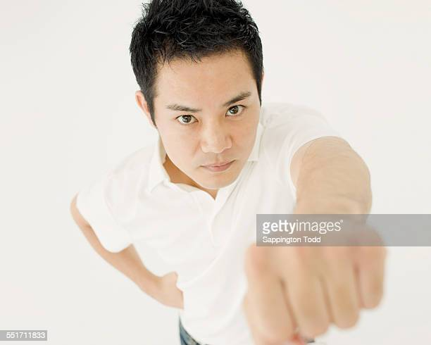 Young Man Clenching Fist