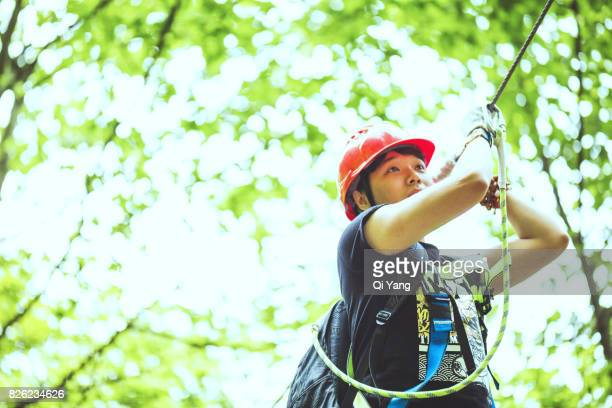 Young man climber in forest ,China