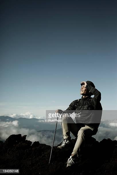 young man climbing the mountain