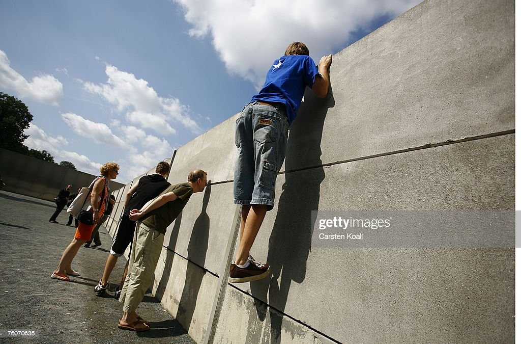A young man climbs up an inner wall at a still-standing portion of the Berlin Wall at Bernauer Street on the 46th anniversary of construction of the Berlin Wall August 13, 2007 in Berlin, Germany. Authorities in the eastern German city of Magdeburg recently discovered a 1973 document of the former East German internal security agency, the Stasi, giving guards at border posts the order to shoot anyone trying to flee the country, even women and children. The document confirms that shooting escapees was an official policy of the former East German government, something former East German politicians have long denied. Over a thousand East Germans died while attempting to escape East Germany for the West.