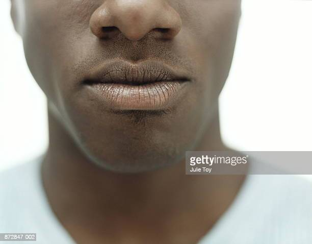 young man, close-up of mouth - lips stock pictures, royalty-free photos & images