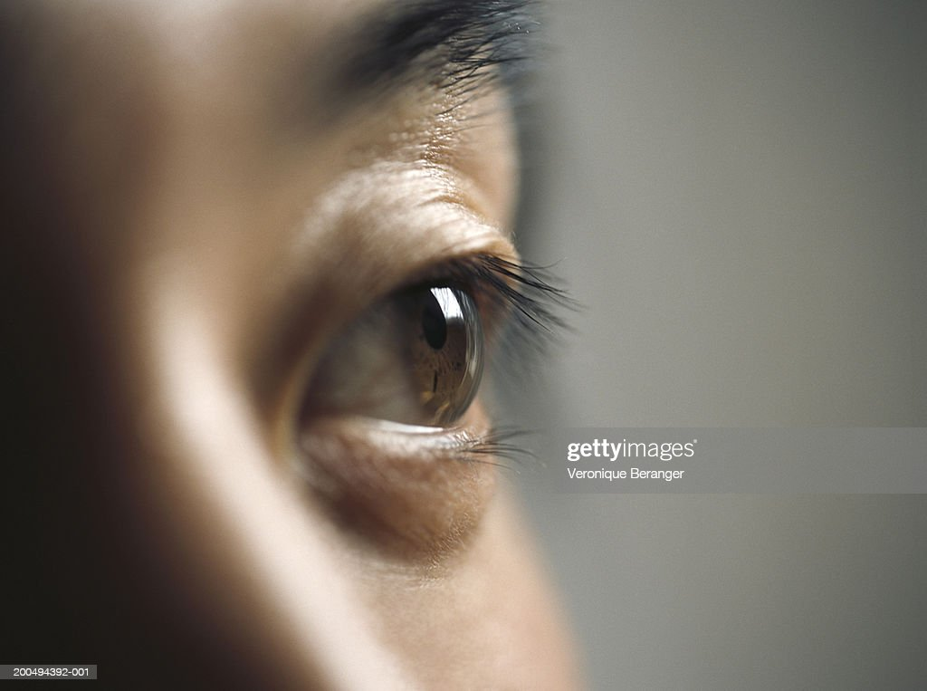 Young man, close-up (focus on eye) : Stock Photo