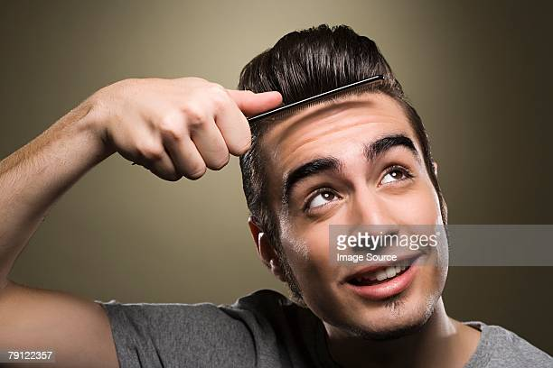 Young man combing his quiff