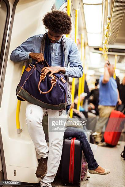 Young man commuting in subway train