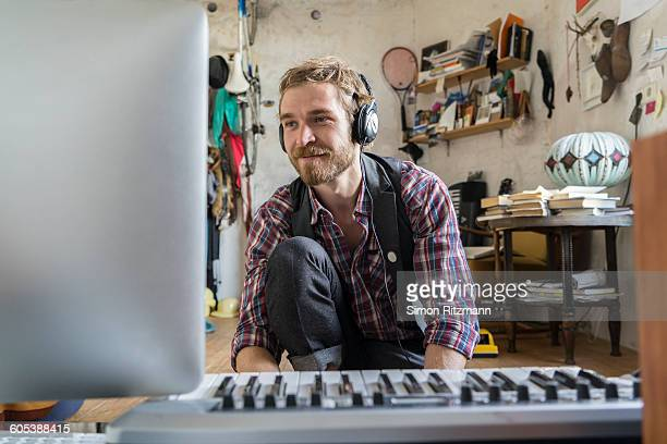 young man composing a piece of music with computer - hobbies stock pictures, royalty-free photos & images