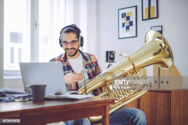 Young man composing music at home