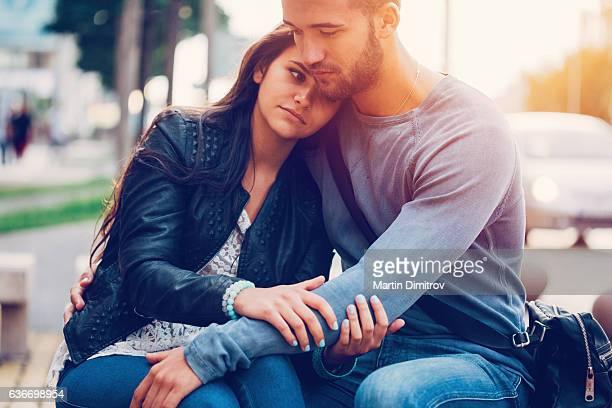 young man consoling his girlfriend - heterosexuelles paar stock-fotos und bilder