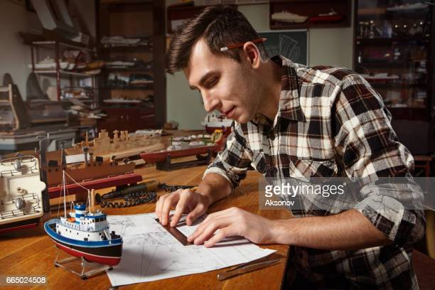 young man constructing a ship model - model kit stock pictures, royalty-free photos & images