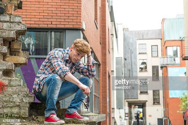 Young man contemplating