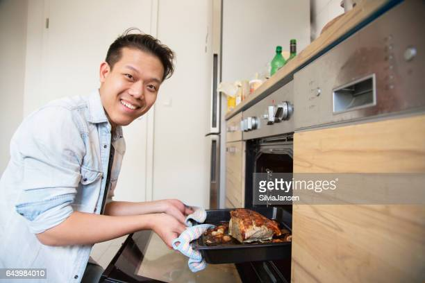 Young man cooking in the kitchen