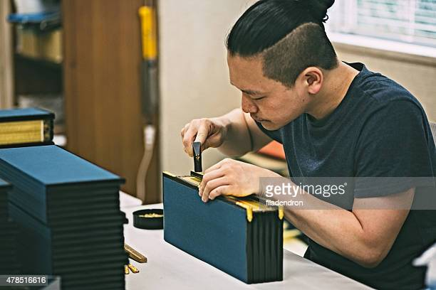 Young man creating a wooden craft box.