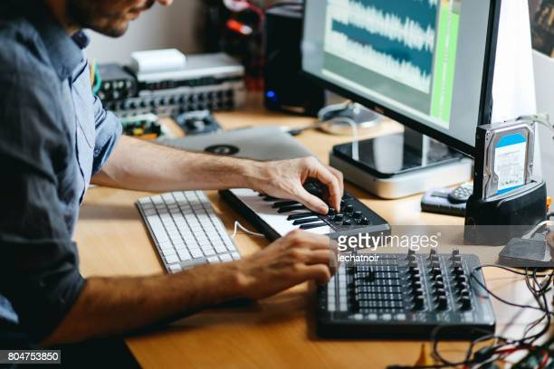 young man creating music at home - music stock pictures, royalty-free photos & images