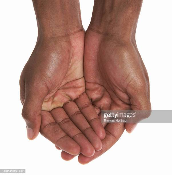 Young man cupping hands, close-up of hands