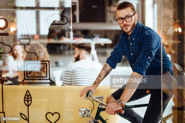 Young man cycling in a startup
