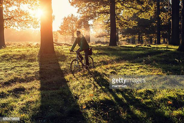 young man cycling in Richmond Park, London