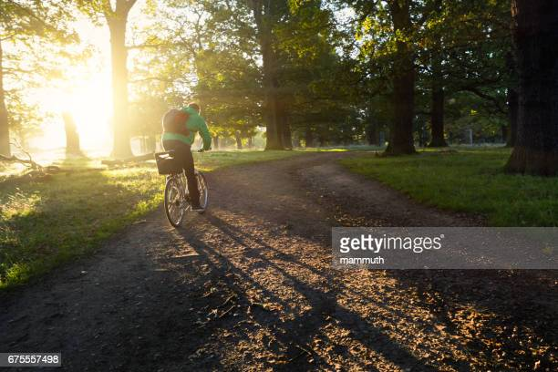 Young man cycling in Richmond Park, London, United Kingdom