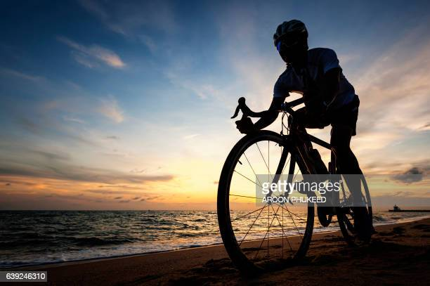 Young man cycling on the beach