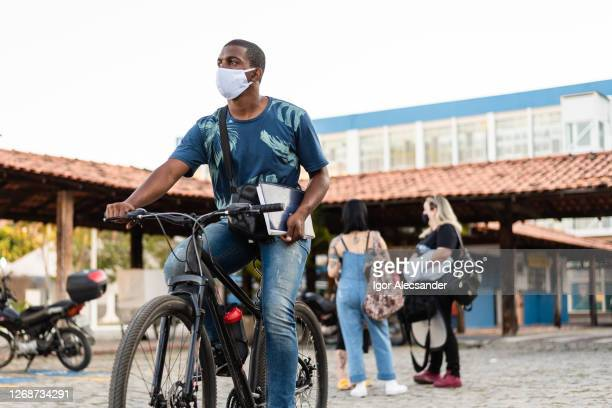 young man cycling on university campus - brazil stock pictures, royalty-free photos & images