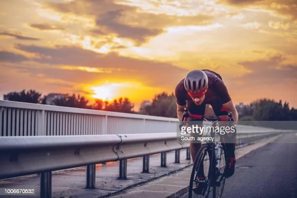 young man cycling - atleta professionista foto e immagini stock
